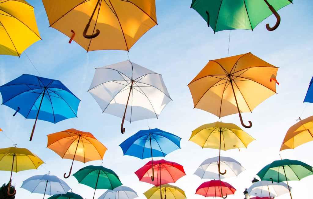 Sustainable, ethical insurance symbolised by colourful umbrellas
