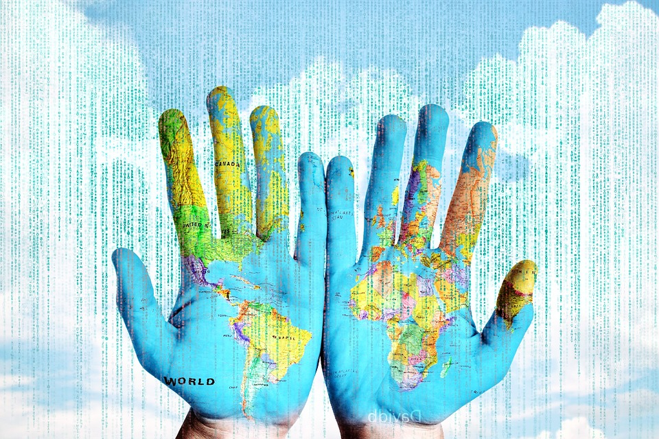 globe painted hands with computer coding over it to represent sustainable search engines